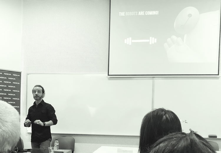 Jody Byrne giving a keynote in a lecture theatre at the University of Aveiro, Portugal