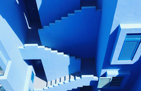 Blue building with maze-like staircases