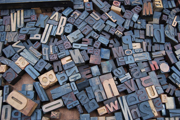 Random wooden blocks with letters